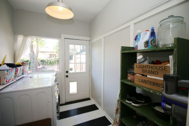 Separate indoor laundry room with doggy door leading to backyard.