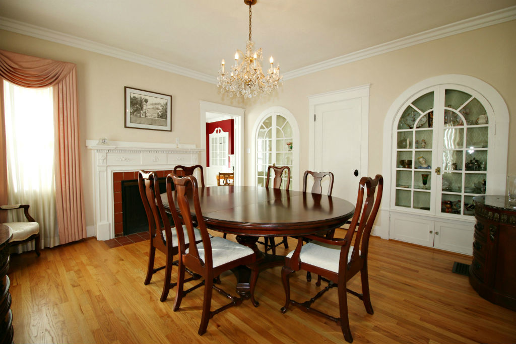 Formal Dining Room With Built In Display Curios Original Hardwood Floors And Fireplace
