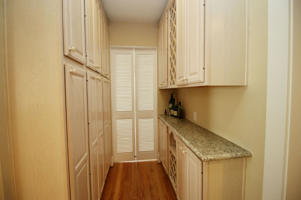 Butler's pantry with doors leading to front parlor.