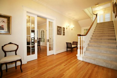Elegant foyer -- note the original French doors leading into the formal dining room.