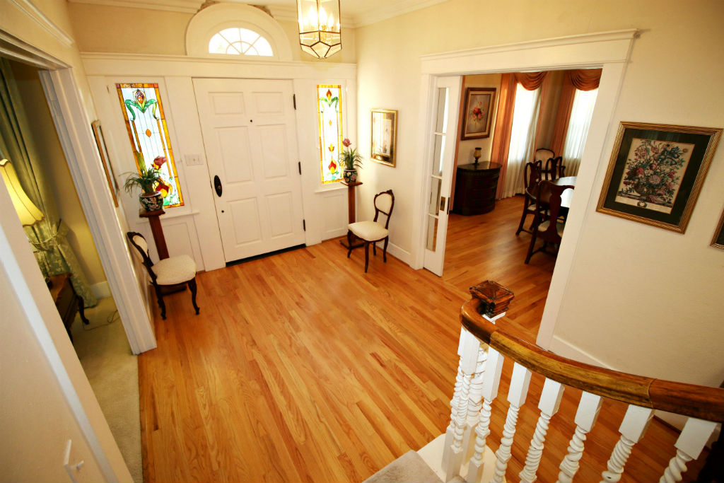 Alternate view of the foyer -- note the stained glass windows flanking the front door.