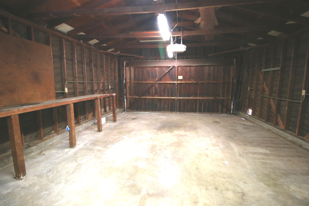 Attached 2-car garage with laundry, work bench, and direct house access.