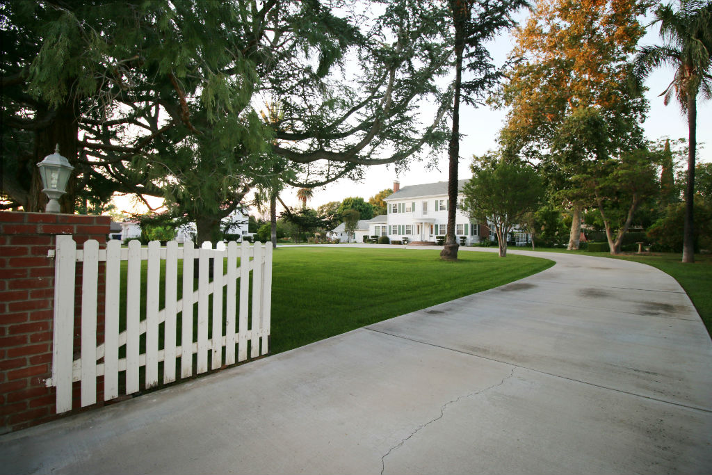 Huge circular driveway with entrance and exit gates.