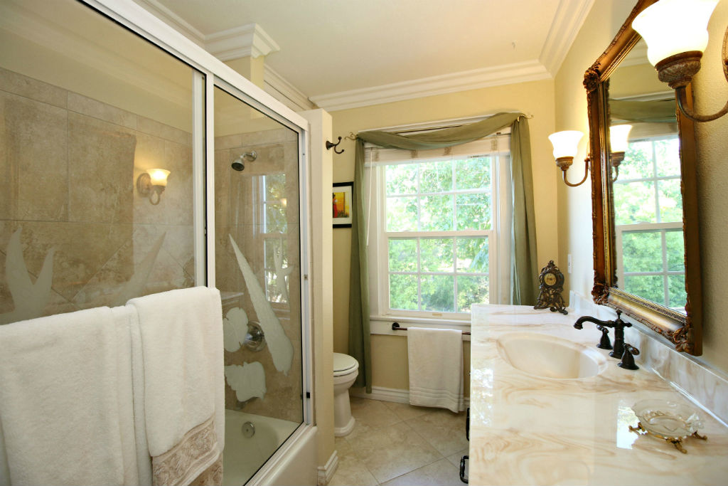 Remodeled upstairs bathroom with shower in tub.