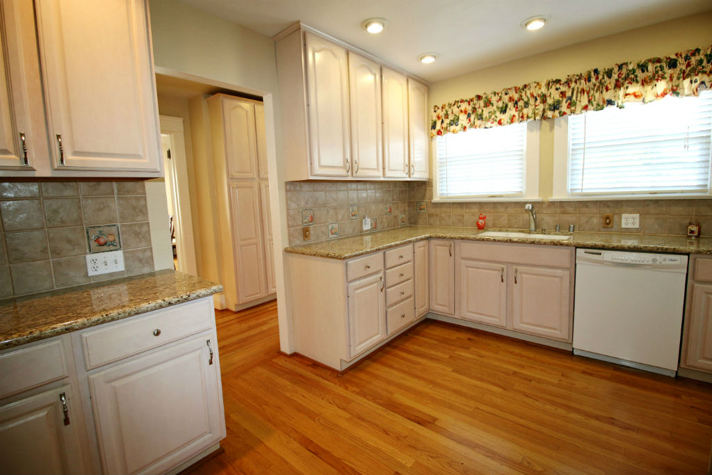 Remodeled kitchen with granite counter tops, dishwasher, and walk-in pantry.