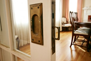 Magnified view of original hardware on one of the pocket doors separating foyer from formal dining room.