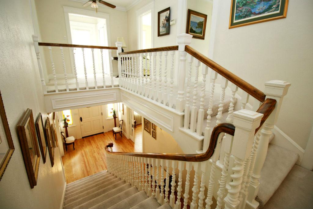 Elegant stairway with original handcrafted balusters.