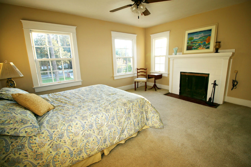 Second upstairs master, this one with fireplace and attached bathroom.