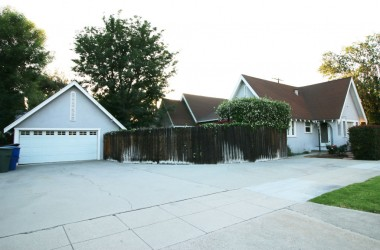 2-car detached garage with lots of parking for 5 cars in addition to two in the garage. Driveway is off of Riverside Avenue and not Jurupa Avenue.