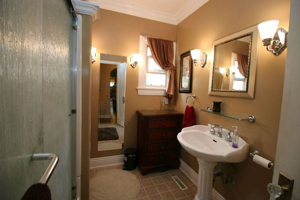 Remodeled hall bathroom with new tub, flooring, fixtures, and toilet.