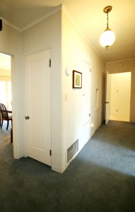 Wide hallway with original telephone alcove.