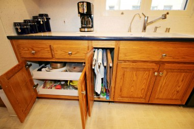 Pull-out drawers, washcloth drying racks, and even pull-out drawers in pantry next to refrigerator.