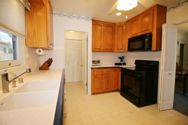 Alternate view of remodeled kitchen with newer appliances.