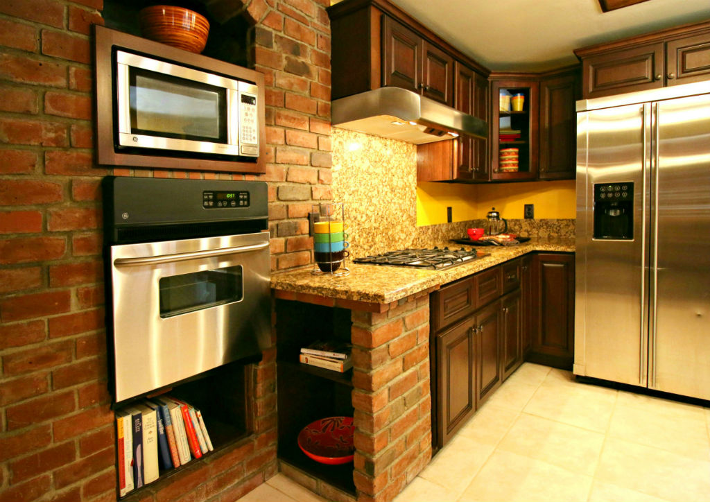 Built-in display shelving for recipe books and/or decorative bowls. Self-closing cabinetry. Refrigerator does not stay.