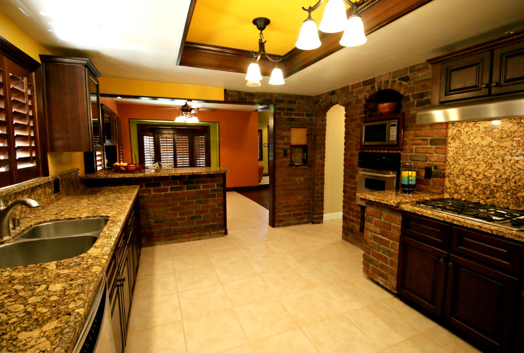 Alternate view of remodeled chef's kitchen looking towards the formal dining room. Granite backsplash, garden window, and lots of counter space.