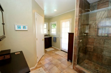 Remodeled private master bathroom with walk-in closet and French door leading to backyard pool/spa!