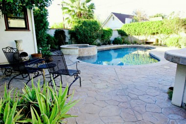 In-ground black-bottom pool with spa, only 15 yrs old. Built-in gas BBQ perfect for entertaining. And don't forget that there are raised garden beds and fruit trees behind the garage!