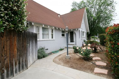 Side yard with rose garden and entry door into the bonus room (office).