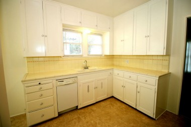 Alternate view of kitchen with dishwasher and original counter tile in wonderful condition.
