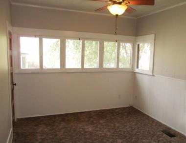 Main floor bedroom #1 with ceiling fan.