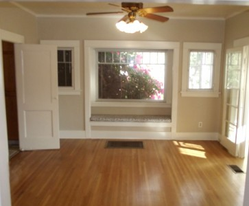 Formal dining room with charming window seat.