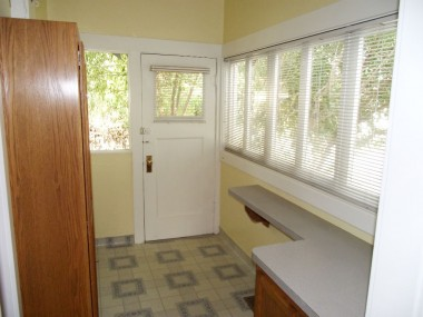 Separate indoor laundry room with long counter top great for folding clean laundry.