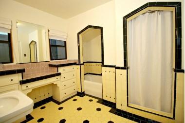 Original alcove bathtub, as well as a separate shower stall.