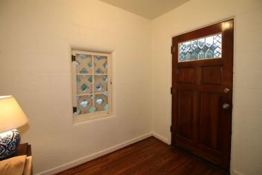 Amazing entry/foyer with original hardwood flooring.