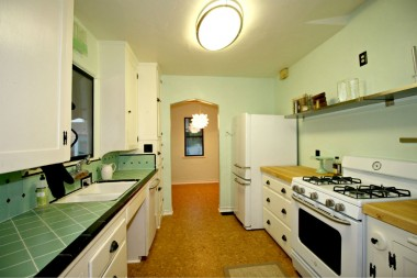 Whole view of kitchen and into breakfast nook.