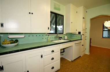Original immaculate tile in kitchen with period hardware, and a spacious breakfast nook.