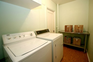 Separate laundry room with adjacent deep closet that once housed a toilet, but the plumbing is still intact for future renovation if another bathroom is desired.