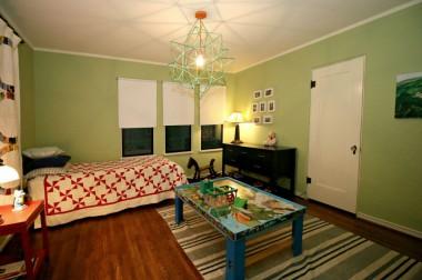 Spacious middle bedroom with original hardwood floors too.