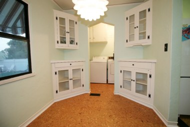 Quaint breakfast nook with two corner hutches and new opening that leads into the laundry room and easy access to park-like backyard.