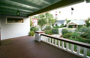 Amazing front porch overlooking the charming front yard and lovely neighboring homes.
