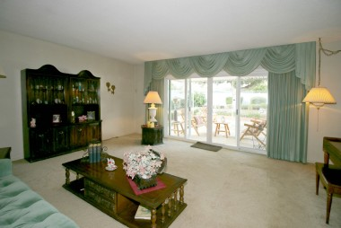Living room overlooking the patio and gorgeous park-like backyard. Newer double pane slider.