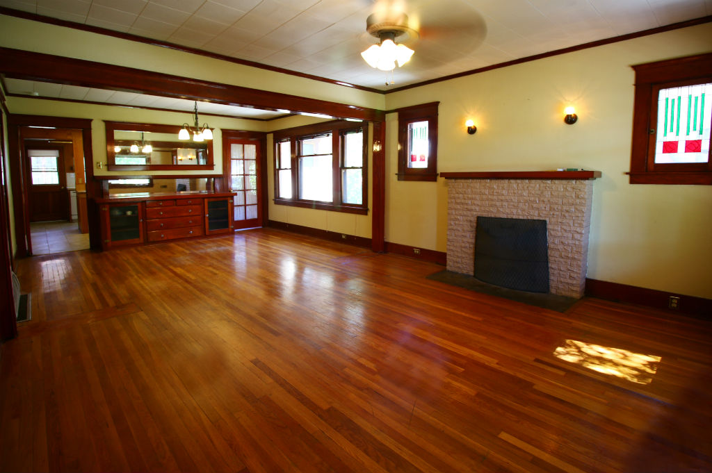 View as you walk through the front door. Wood/gas fireplace, ceiling fan, original hardwood floors, and original windows. Stained glass panels will be replaced prior to close of escrow.