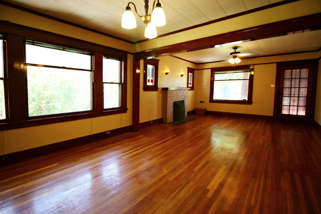 Alternate view of living room from the dining area. Gorgeous original hardwood floors, and those original windows are simply charming.