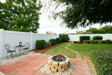 Fire pit, sitting areas, citrus, large shade tree...what a functional and beautiful back yard!