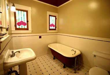 Updated bathroom with clawfoot tub, pedestal sink, and newer toilet. Stained glass windows will be replaced prior to close of escrow.