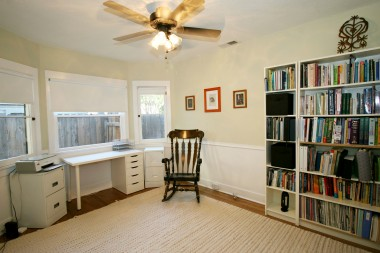 First of two bedrooms, with hardwood floors and ceiling fan (book cases do not stay).