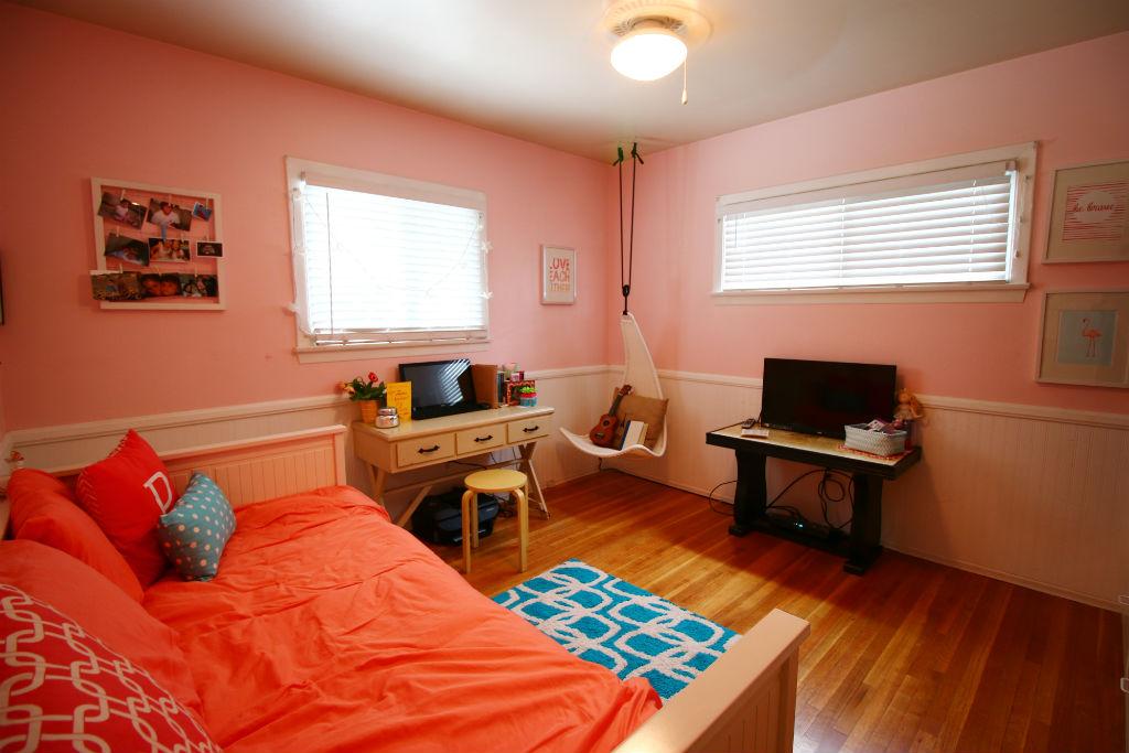 Large bedroom with gorgeous hardwood floors.