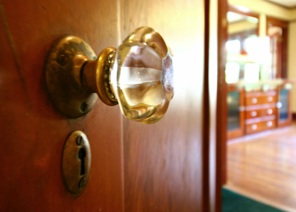 Glass doorknobs and skeleton key holes.