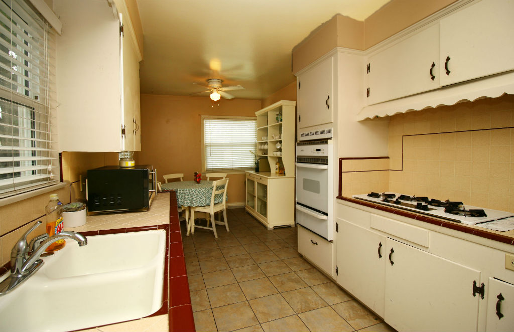 Amazing retro kitchen with newer stove and gas range top, as well as dishwasher -- and refrigerator is included!