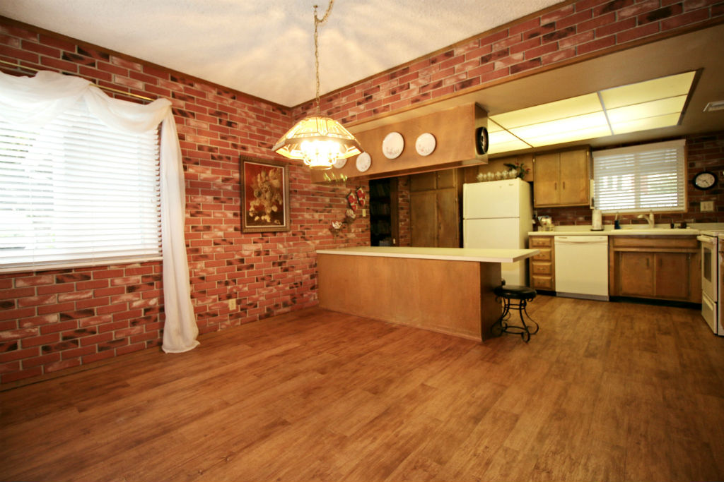 Spacious eat-in kitchen with large bar and corner windows that let in lots of natural light.
