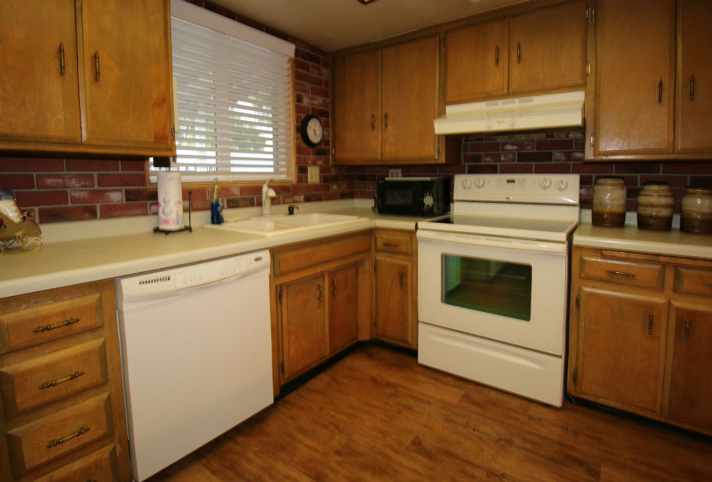 Dishwasher, electric range, and lots of cabinetry.
