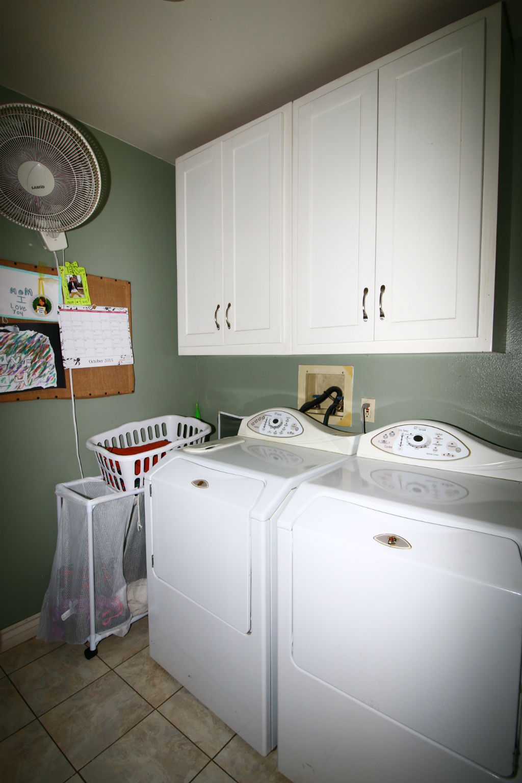 Separate laundry room with lots of cabinetry -- late model washer/dryer units are included.