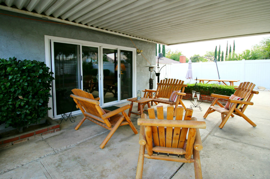Covered patio right off the living room. Wait til you see the rest of the yard!