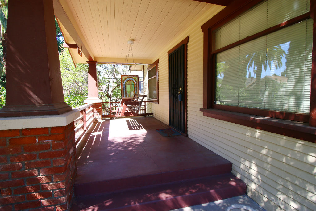 Large front porch with swing. Best neighborhood to hang out on front porch and watch the world go by with a morning coffee or afternoon lemonade!