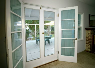 Original French doors in dining area leading to the patio and back yard.