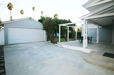 Full-size detached 2-car garage with modern automatic roll-up door.